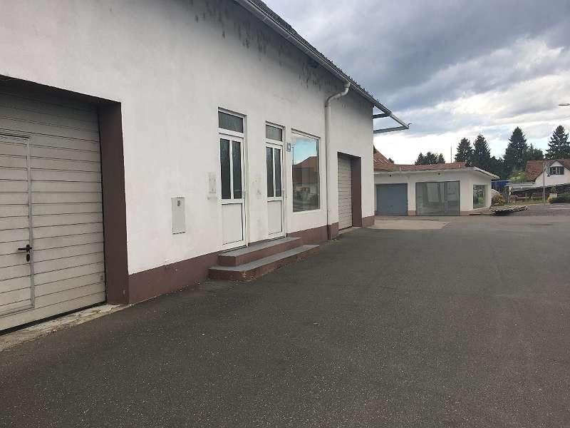 Büro mit Lagerflächen und Wohnung und Garagen