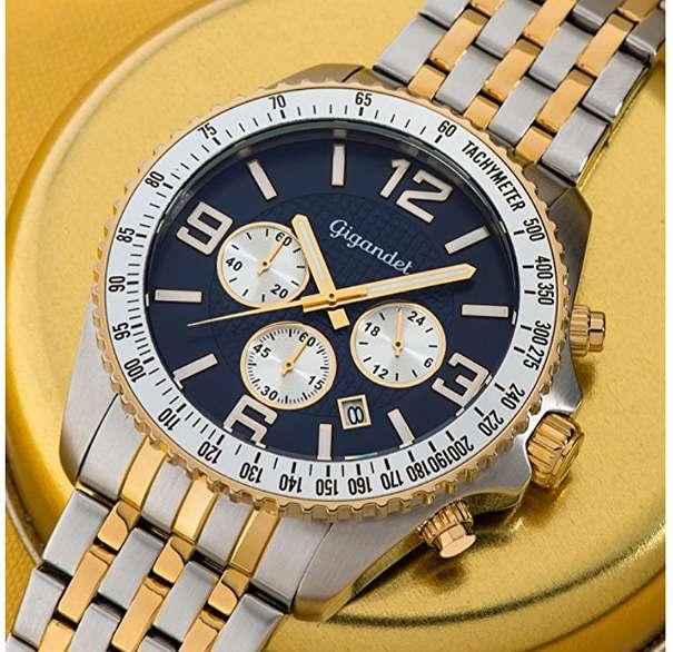 Gigandet Herrenarmbanduhr in Gold Blau - Salzburg - Verkaufe 1 Jahr alte Uhr, funktioniert einwandfrei!Chronographen-Uhrwerk von TMI, Kaliber VD53 Anzeige von Datum und 24-Stunden Massives Edelstahlgehäuse (316L), das höchsten Ansprüchen genügt Gehärtetes, kratzfestes Mineralglas Verschraub - Salzburg